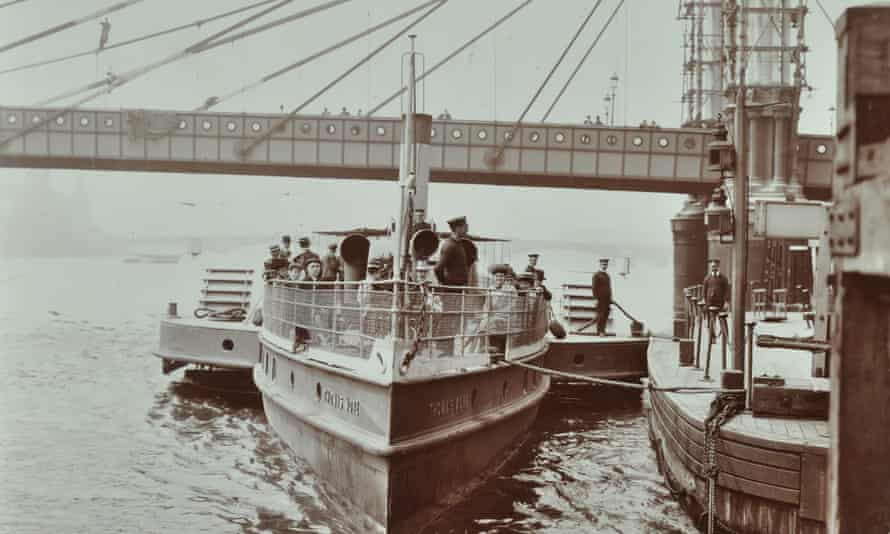 The London County Council steamboat Thomas More, moored against the pier next to a bridge being rebuilt, 1907.