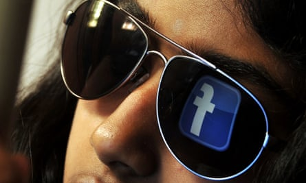 facebook logo in a woman's glasses