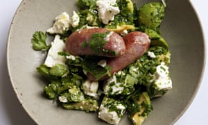 Sausages with avocado and feta in a ceramic bowl