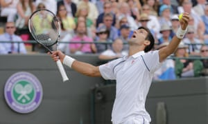 Serbia's Novak Djokovic reacts after serving an ace against South Africa's Kevin Anderson.
