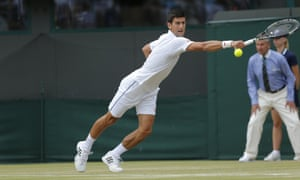 Novak Djokovic attempts to return the ball to Kevin Anderson.