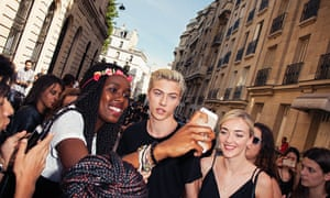 'They just want a photo and a hug': Lucky Blue Smith meets his fans on the streets of Paris, accompanied by his sister Daisy Clementine (on right).