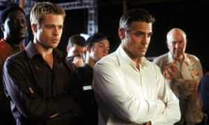 Brad Pitt, left, and George Clooney on the set of Ocean's Eleven in 2001.