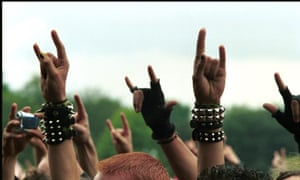 Picture of music fans making devil's horns symbols with their hands