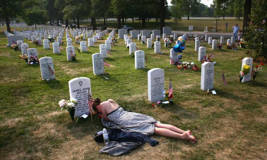 Mary McHugh mourns her dead fiance James Regan at Section 60 in the Arlington National Cemetery on 27 May 2007.