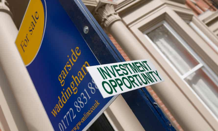 Estate agent and investment opportunity sign outside a house