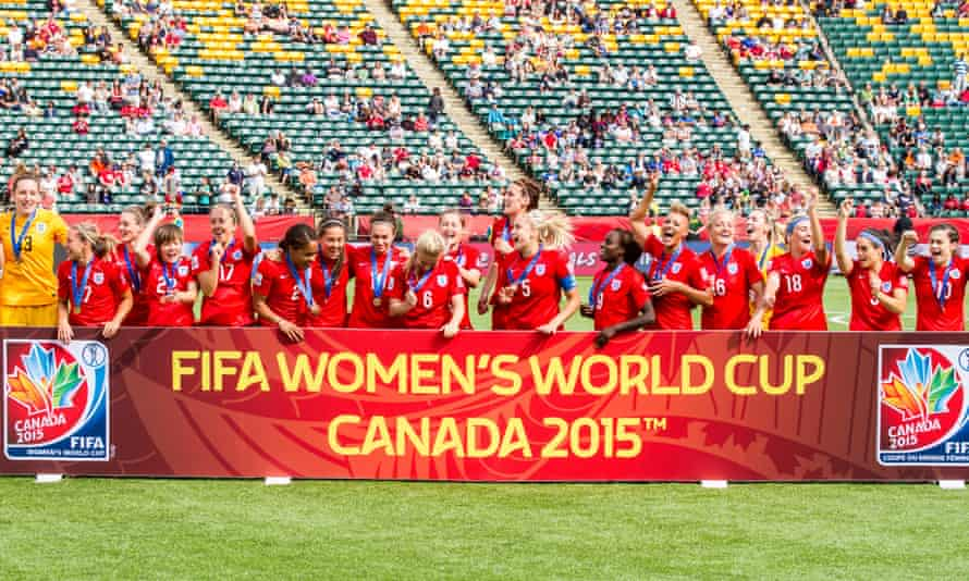 The English Women's team celebrates coming third at the World Cup in Canada.