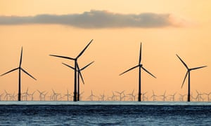 A sea of wind turbines can be seen from the beach at Crosby, Merseyside.