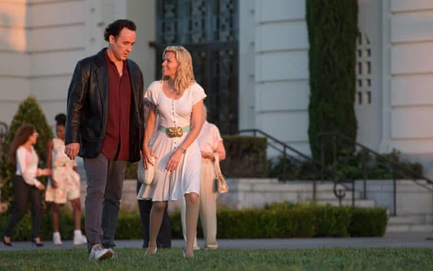 John Cusack as Brian Wilson Elizabeth Banks as Melinda Ledbetter in Love & Mercy.