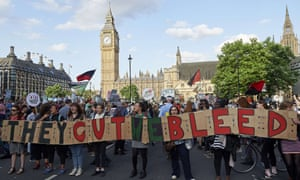 Protesters take part in a demonstration in London against George Osborne's budget announcement.