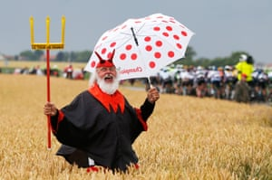 Dieter 'Didi' Senft, the self styled devil of the Tour de France, cheers on the riders during stage five , a 189.5km run between Arras and Amiens.