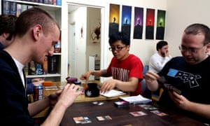 Magic: The Gathering players play at a game store