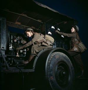 Auxiliary Territorial Service girls operate a mobile power plant on an anti-aircraft gun site at night