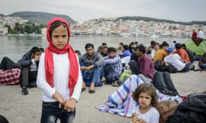 Newly arrived refugees wait to be registered in Mytilini harbour, Lesbos.