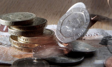 Money falling on desk