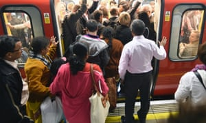 Passengers squeeze aboard on Wednesday evening.