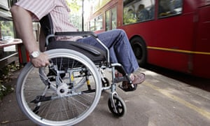 England, London, Disabled man in wheelchair at bus stop