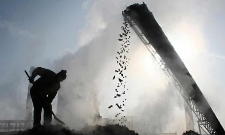 A labourer works at a coal factory in Baicheng county, northwest China's Xinjiang Uygur Autonomous Region.