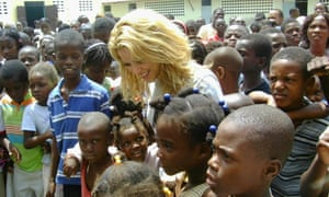 Shakira meets survivors of Haiti's earthquake when her charity was building a school in the country.
