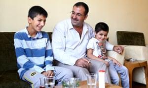 Abu Shujaa shares a light moment with his sons Hassan (left) and Shujaa in Iraqi Kurdistan.