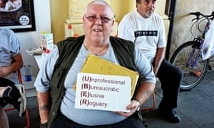 A protester holds an anti-Uber sign during a United Cabbies Group (UCG) demonstration last month.