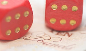two dice on a ten pound note