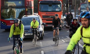 Cyclists negotiate rush hour traffic in central London near Waterloo Station, England.