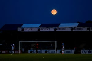 The moon rises over the memorial ground during the Bristol Rovers v West Bromwich Albion match.