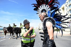 A matter-of-fact police officer advises one festival-goer of the new route after a bomb scare