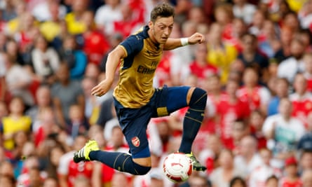 Mesut Özil acrobatically controls the ball during Arsenal's Emirates Cup win over Lyon last weekend.