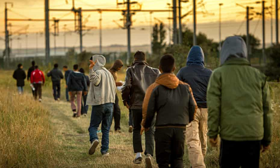 Migrants near Calais earlier this month.