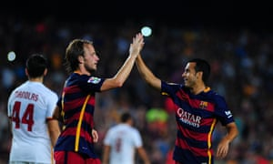 Barcelona's Ivan Rakitic, left, celebrates with Pedro during the recent game against Roma at Camp Nou.