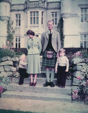 Philip and Elizabeth stand with Princess Anne and Prince Charles outside Balmoral Castle, September 1952.