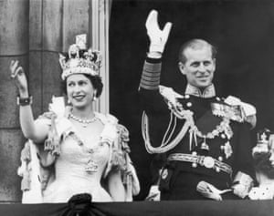 Queen Elizabeth II and the Duke of Edinburgh wave at the crowds from the balcony at Buckingham Palace, 1953