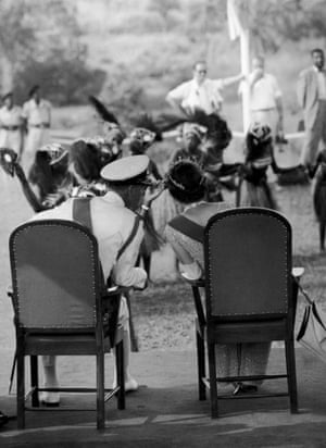Queen Elizabeth II and Prince Philip are entertained by Susu dancers during an official visit to Port Loko, Sierra Leone, December 1961.