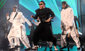 Psy performs with MC Hammer in 2012 in LA.
