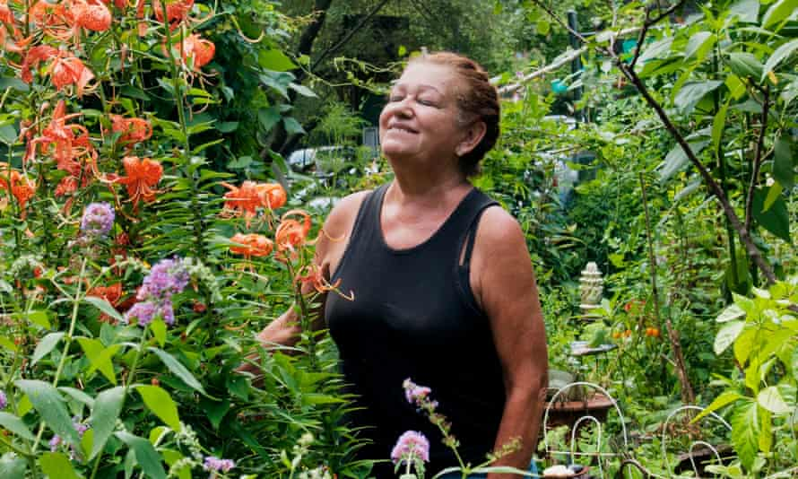 Marta Montañez stands in her garden in 9th Street Community Garden Plaza, at 9th street and Avenue C.