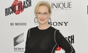 Meryl Streep wears a black dress and large black hoop earring, her hair tied back with a loose fringe, for a photocall for her new film Ricki and the Flash