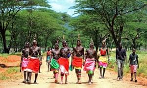 Samburu men walking to a festival in northern Kenya in 2012. Photograph: Carl De Souza/AFP/Getty Images