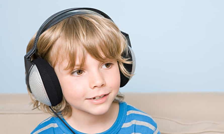 A boy listens to an audiobook