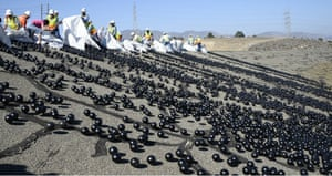 About 20,000 polythene balls are released into the Los Angeles reservoir at the Van Norman complex in Sylmar, California