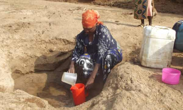 woman sand dam kenya
