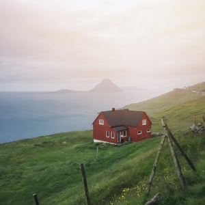 The Faroe Islands are home to only 50,000 people, and you often find very small settlements made up of amazing little houses like this one set, against an epic backdrop of open ocean.