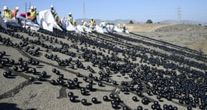 The final 20,000 of 96m black balls are released into the Los Angeles reservoir to help conserve water in drought-stricken California