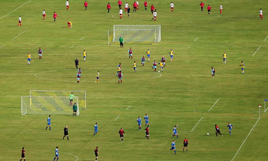Sunday league players in action at London's Hackney Marshes. Photograph: Julian Finney/Getty Images