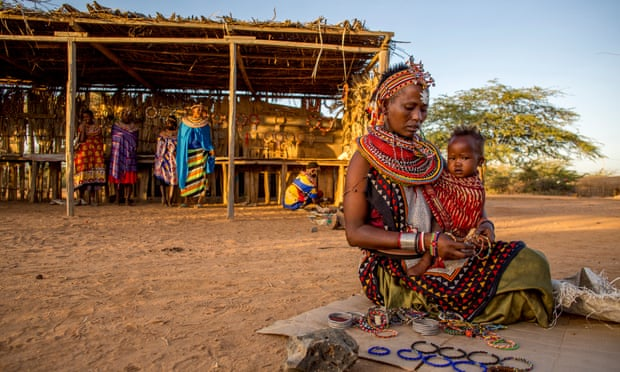 Craft work: ChinaLaprodati with her baby selling her jewellery.