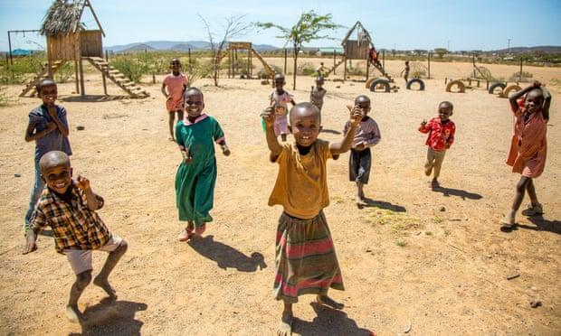 Child's play: nursery school children. Some 200 children live in the village.