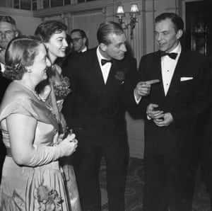 As host, Philip talks to Frank Sinatra at a party for members and friends of the Variety Club of Great Britain, at the Empress Club, London, December 1951.