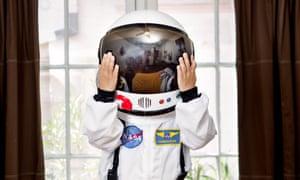 Child in a mini astronaut suit