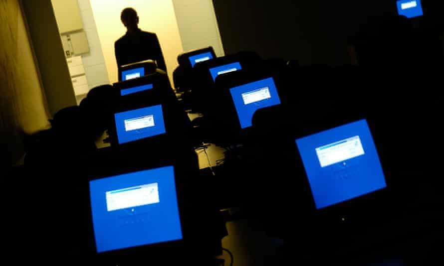 Computer screens in empty room